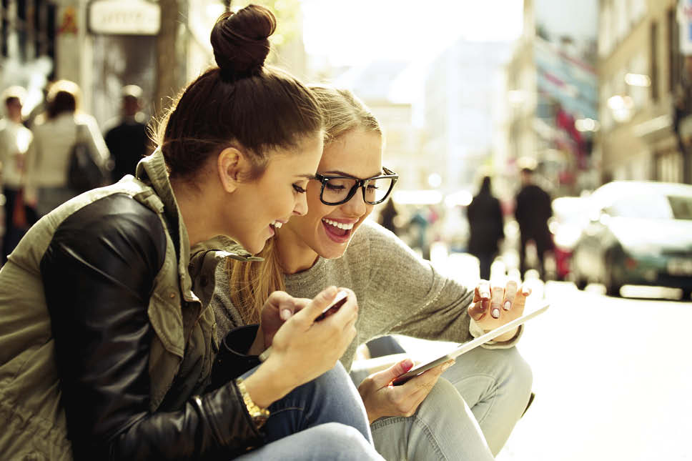 young women on mobile devices